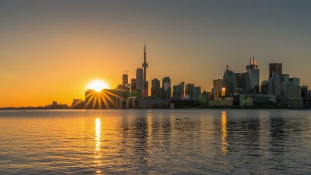 toronto sunset city skyline reflections at polson pier - toronto architecture stock videos & royalty-free footage