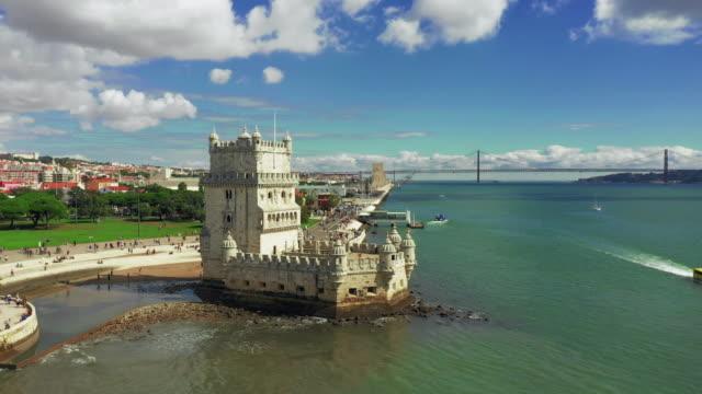 vídeos de stock e filmes b-roll de torre de belem by tagus river in lisbon portugal aerial - lisboa