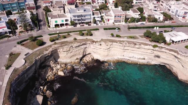 torre dell'orso, lecce, puglia, italy. aerial view of the city, sea and cliffs - lecce video stock e b–roll