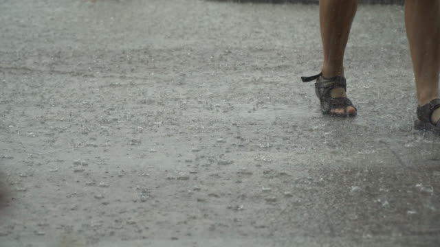 Torrential Rain and Running People