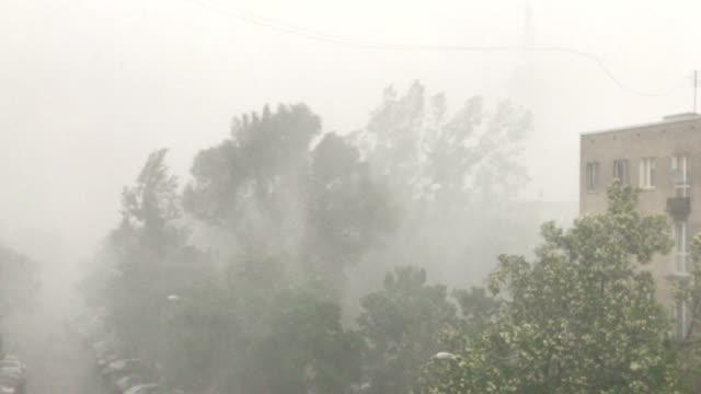 torrential rains accompanying sudden outbursts of storms in  polish city - burza filmów i materiałów b-roll