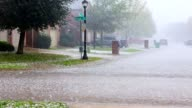 istock Torrential Rainstorm With Hail In Urban Residential Street 1178161051