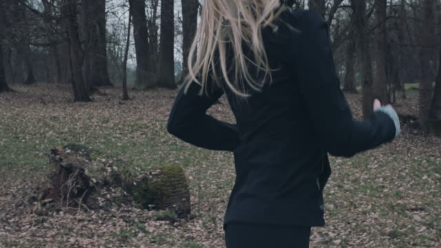 Torso of a woman out jogging in a park video