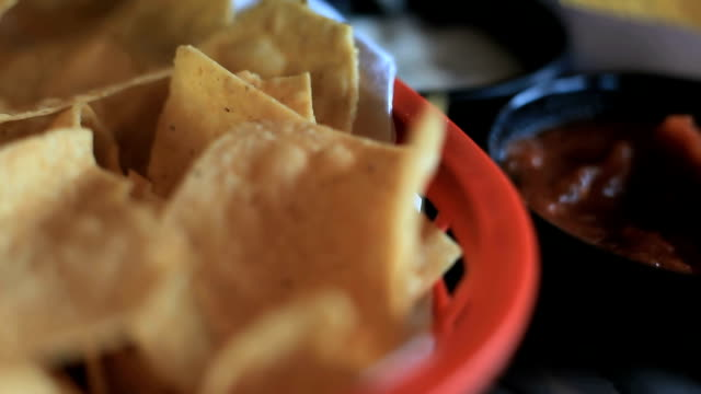 Tortila chips, salsa, appetizer, dip, mexican food Tortila chips, salsa, appetizer, dip, mexican food dipping sauce stock videos & royalty-free footage