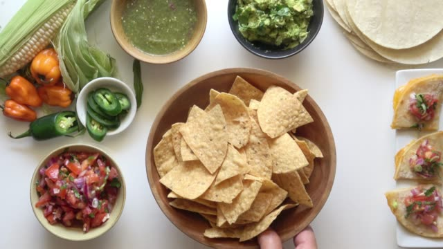 Tortilla Chips and Salsa. Serving Fresh Mexican Food on a Bright White Background. dipping sauce stock videos & royalty-free footage