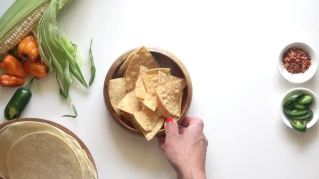 Tortilla Chips with Guacemole and Salsa Verde. Serving Fresh Mexican Food on a Bright White Background with copy space. dipping sauce stock videos & royalty-free footage