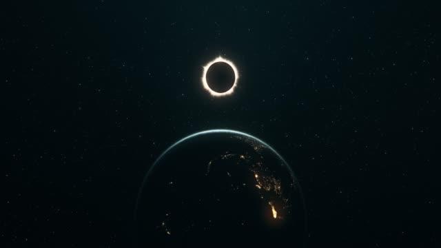 total sol förmörkelse sett från yttre rymden (vertikal rörelse) - earth from space bildbanksvideor och videomaterial från bakom kulisserna