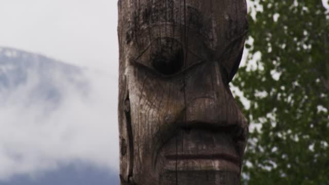 Totem poles in beautiful landscape in Alaska