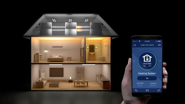 iot モバイル アプリケーションに触れる、暖房システム省エネルギー効率制御、スマート家電、モ ノのインターネット。 - アイコン点の映像素材/bロール