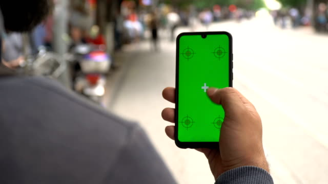 Touching Mobile Phone Screen in Public Area