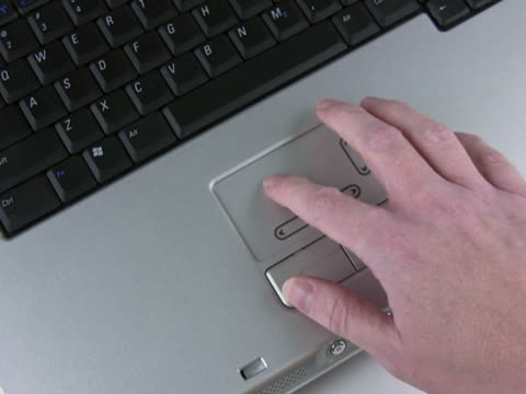 ntsc: touchpad di un computer laptop - touchpad video stock e b–roll