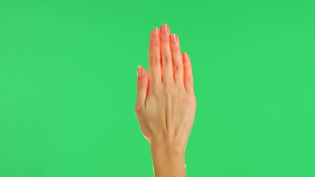 Touchscreen hand press gesture with glow on green screen video