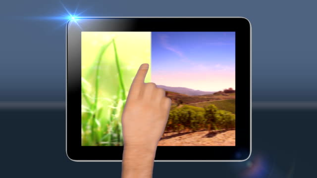 Touchscreen tablet with green screen transition. HD video