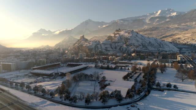 tourbillon stadyumu ve tepeler - hava 4k - phantom 4 pro - mountain top stok videoları ve detay görüntü çekimi
