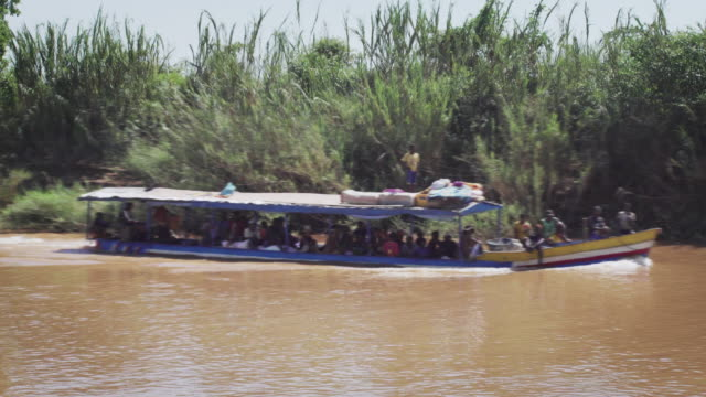 Tourboat on the river Tourist boat moving along river. Madagascar madagascar stock videos & royalty-free footage