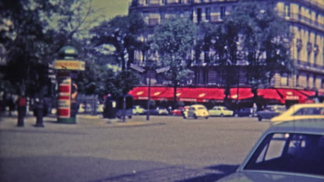 AMSTERDAM - 1969: Touring around the city at landmarks with busy traffic streets.