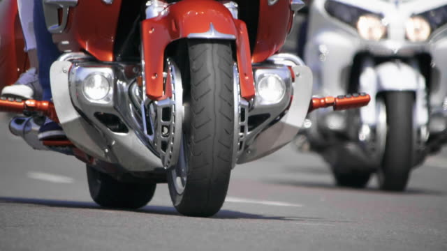 HD - Touring motorcycles. Bottom view of a Bikers riding