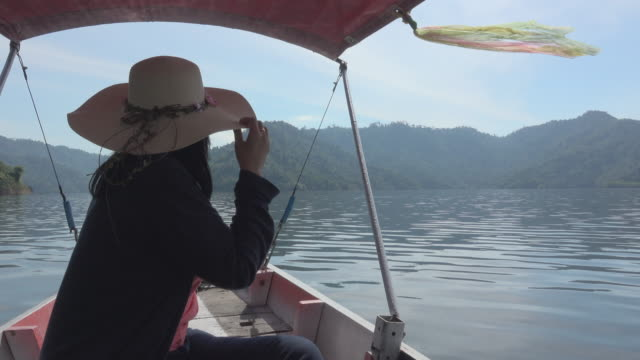 Touring Woman On Taxi Boat