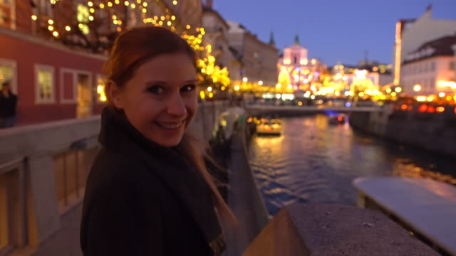 Tourist admiring Ljubljana at christmas time at night video
