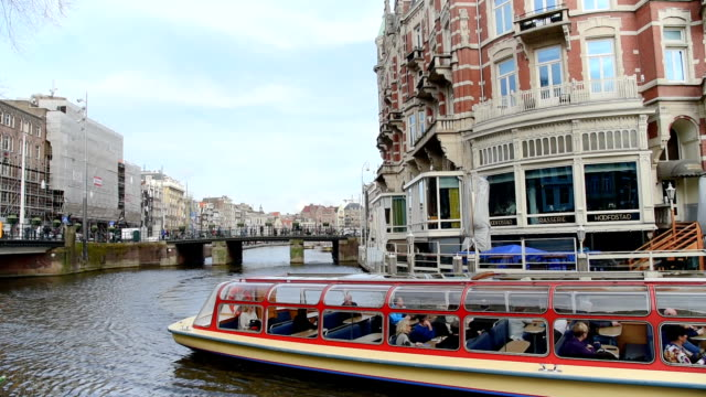 Tourist and Street Traffic tram & Boats at Amsterdam  Amsterdam, Netherlands video