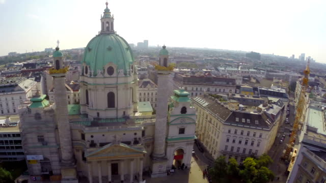 Tourist architecture Vienna, Karlskirche European Baroque aerial. Beautiful aerial shot above Europe, culture and landscapes, camera pan dolly in the air. Drone flying above European land. Traveling sightseeing, tourist views of Austria. video