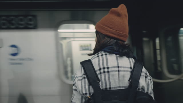 Tourist asian woman waiting train on subway platform. Hipster asian woman waiting train and standing in metro, New York, USA railroad station platform stock videos & royalty-free footage