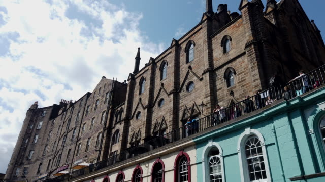 Tourist at Victoria street Royal Mile in old town Edinburgh Scotland UK