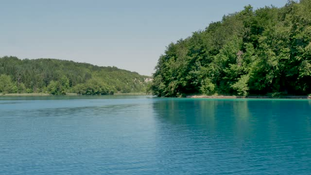 Tourist boat floating on the river in Plitvice Lakes in Croatia video