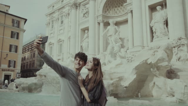 tourist couple taking a selfie in rome - fountains stock videos & royalty-free footage