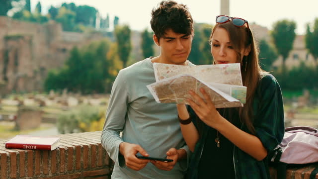 Tourist couple with a map by the Roman forum in Rome video