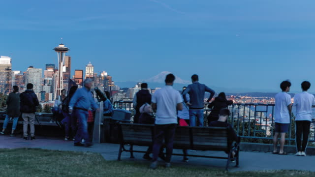 Tourist Crowd Hyperlapse of Seattle Skyline and Mt Rainier from Kerry Park Scenic world travel motion timelapse looking over major American city from popular viewpoint with people taking pictures and sight seeing seattle stock videos & royalty-free footage