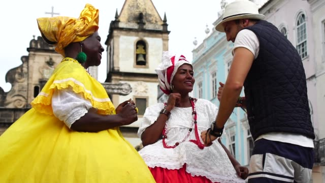 Tourist Dancing and Throw his hat for Native Woman Brazilian People - 'Baiana' video