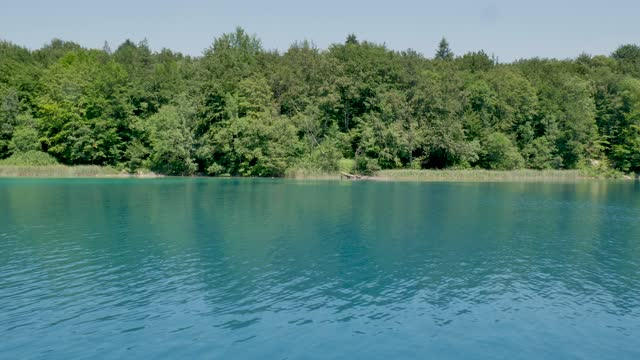 Tourist Electric Boat Floating on Turquoise Waters of Plitvice lakes, Croatia video