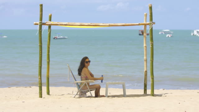 Tourist enjoying the summer on Japaratinga beach in Alagoas, Brazil