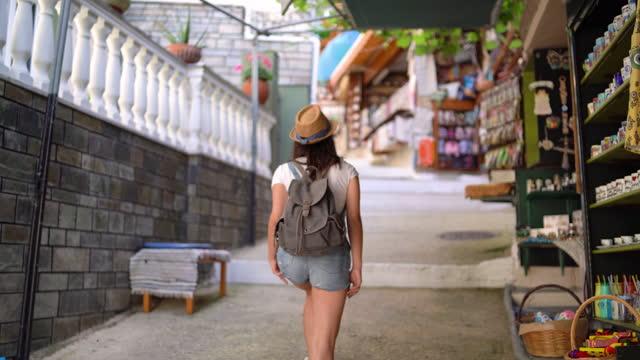 Tourist exploring street of Parga