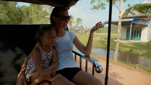 Tourist family mother and daughter riding on traditional tuk tuk transportation video