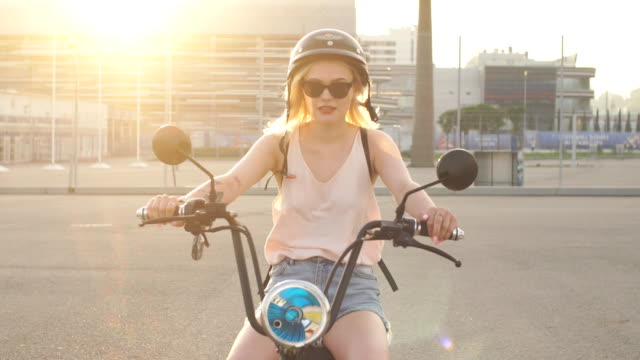 tourist female taking a tour to exploring around town using electric bicycle - tatuaż filmów i materiałów b-roll