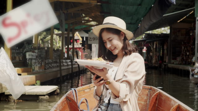 Tourist female travel at floating market