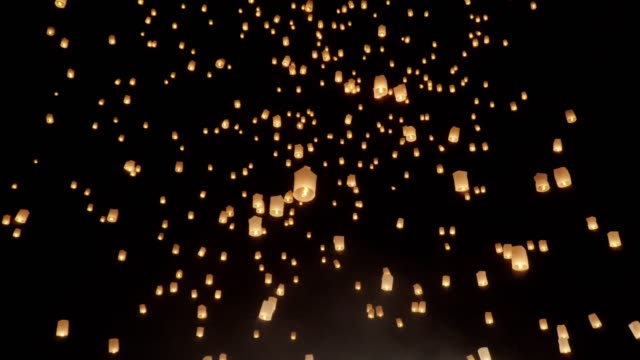 tourist floating sky lanterns in loy krathong festival , chiang mai ,thailand. - sky lantern stock videos and b-roll footage