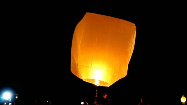 Tourist gathered during launching large floating lantern