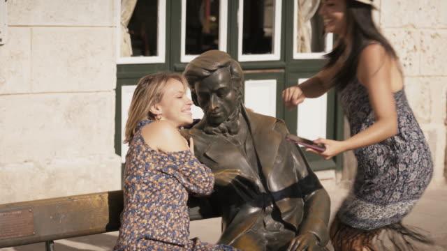 Tourist Girls Taking Selfie Near Statue In Habana Cuba video