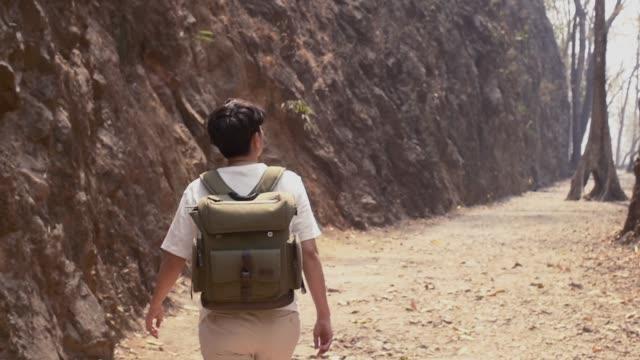 tourist guy walking in hellfire pass rock moutain to discover at Kanchanaburi video