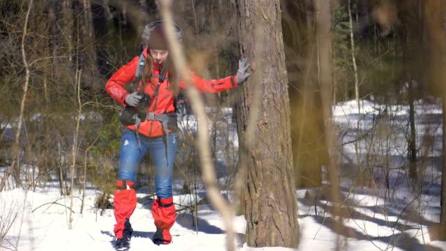 Tourist hardly walking through a deep snow. video