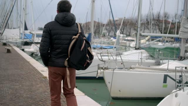 Tourist is walking on embankment of Via destra del port in Rimini