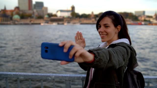 Tourist making selfies / vlogging in Hafen City