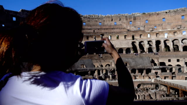 Tourist making video with smartphone inside the Colosseum, Rome, Italy video