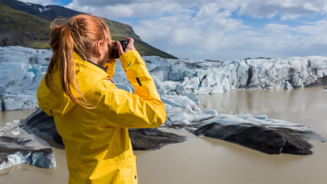 Tourist photographing Iceland's glacier video