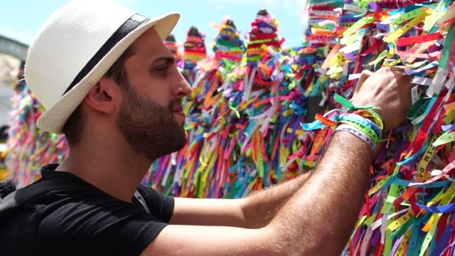 Tourist Praying and Making Wishes in Bonfim Church, Salvador, Bahia, Brazil video