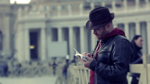 tourist reading a guide near the Basilica of St. Peter video