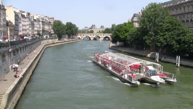 Tourist River Boat Cruising on the River Seine in Paris